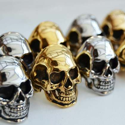 Gold and silver skull biker rings